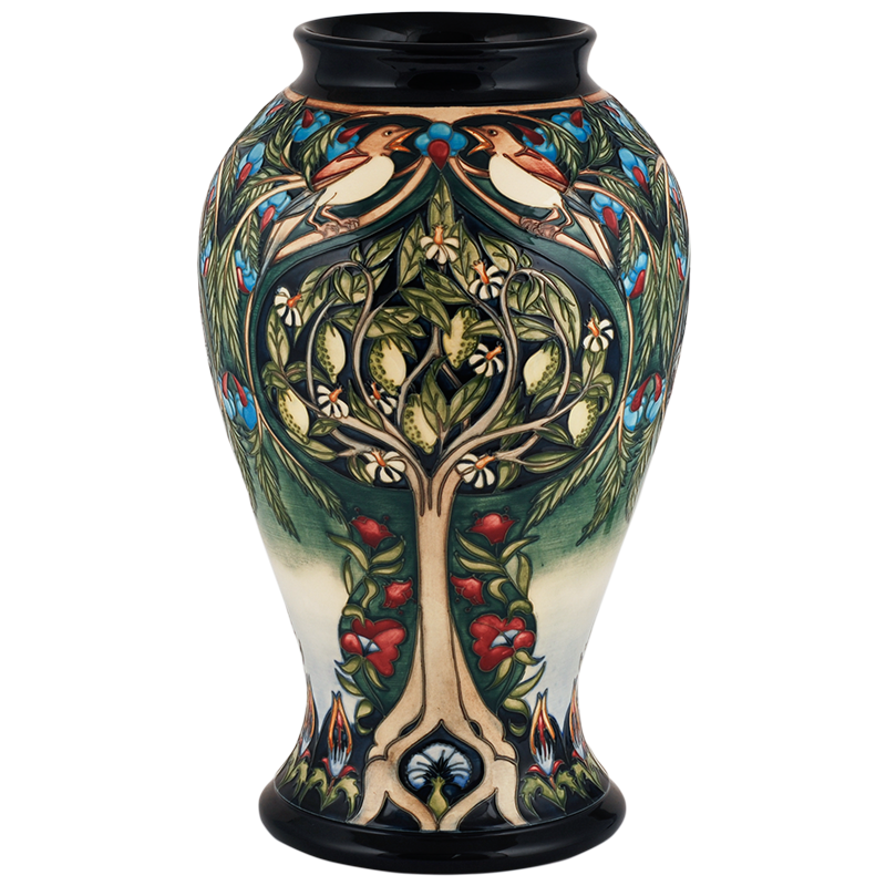 "Caravan-65-16: Caravan Moorcroft Vase<br>Rachel Bishop is a true disciple of the<br>rts & Crafts designer William Morris<br>and this stunning prestige vase was inspired by<br>one of his tapestry designs from 1885 featuring<br>a woodpecker in the branches of a fruit tree.<br>It tells the legend of King Picus.<br>Height:16""<br>Intro Date: 2003"
