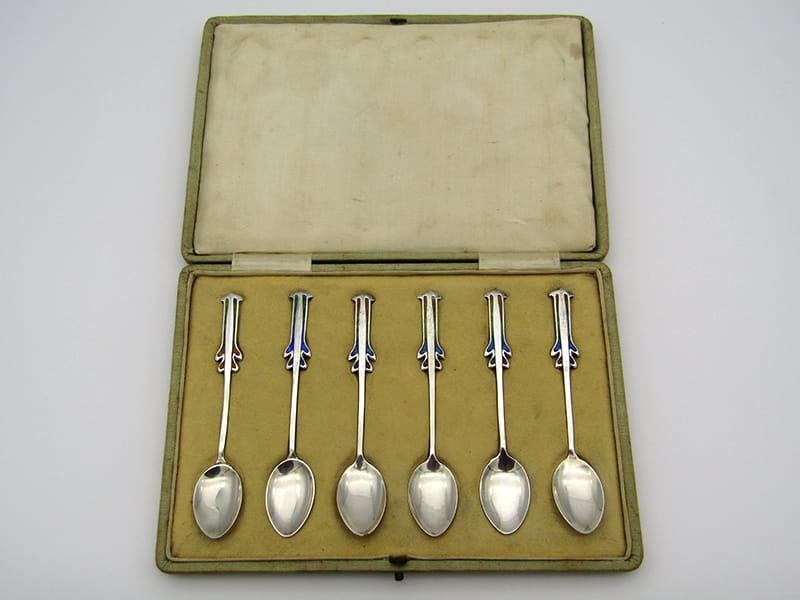 A set of six silver Arts & Crafts enamelled spoons, five of which <br>were designed by Archibald Knox for Liberty & Company <br>and one of which was made by William Hair Haseler. All were made<br>in Birmingham and ranges from 1900 to 1904 in date.