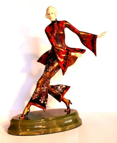 'Charleston Dancer'<br>Also known as 'Rhythmic Dancer'<br>By Gerdago Circa 1925<br>A rare bronze and ivory figure of a dancer, <br>wearing an extremely decorative slack suit.<br>Her hands and face are ivory, and she<br>stands on a green onyx base.<br>Height: 27.5 cms<br>Signatures: Unsigned<br>Reference: (i) Victor Arwas, Art Deco <br>Sculpture Chryselephantine Statuettes<br>of the Twenties and Thirties, <br>Academy Editions, 1975,<br> pictured page 8 frame V.<br>(ii) Alberto Shayo, Statuettes of the<br>Art Deco Period, ACC Art Books, 2016, <br>pictured page 99,<br>called Rhythmic Dancer.