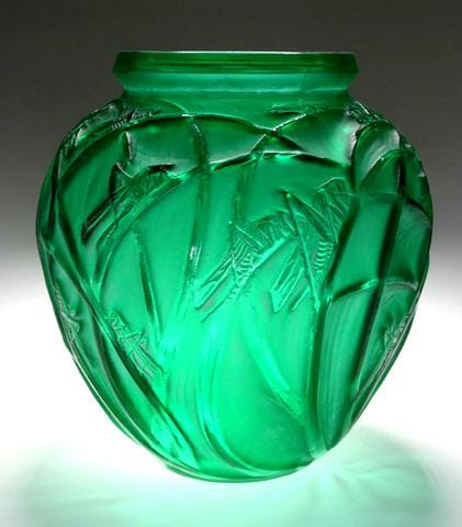 Emerald Green  Sauterelles<br>By Rene Lalique First executed in 1913<br>A large green glass vase, of spherical shape,<br>with a wide aperture, the body decorated<br>with grasshoppers perched on long stalks<br>of grass.<br>Height:  28 cms<br>Signatures:  Engraved script 'R Lalique<br>France' on edge of base<br>Reference: (i) Felix Marcilhac,<br>Rene Lalique – Catalogue Raisonne Des Oeuvres<br>de Verre, Paris, 1989, p. 414, No. 888.<br>  (ii) Patricia Bayer & Mark Waller,<br>The Art of Rene Lalique, 1988, p. 34.
