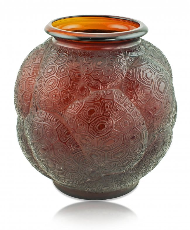 Red Amber Tortues<br>By Rene Lalique First executed in 1926<br>An extremely rare large rich red amber glass<br>vase,of bulbous shape, with a<br>repeated design of the backs of tortoises,<br>the recesses in matt glass with<br>a white patina.<br>Height: 27 cms<br>Signatures:  Moulded R Lalique<br>and engraved script France on base<br>Reference: (i) Felix Marcilhac,<br>Rene Lalique – Catalogue Raisonne<br>Des Oeuvres de Verre, Paris, 1989,<br>. 432, No. 966.<br>(ii) Patricia Bayer & Mark Waller,<br>The Art of Rene Lalique, 1988,<br>p. 30, frame 32.
