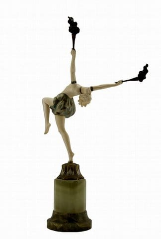 'Torch Dancer'<br>By Ferdinand Preiss (1882-1943) Circa 1920<br>A bronze and ivory young female dancer<br>holding aloft a flame in each hand, balancing <br>on one leg, clad only in pantaloons, and <br>arched backwards, on a green onyx base.<br>Height: 43 cms <br>Signatures: Engraved 'F Preiss' in <br>the maquette<br>Reference (i) Bryan Catley, Art Deco <br>and Other Figures, Antique Collectors' Club, <br>London, 1978, p. 281.<br>(ii) Alberto Shayo, Ferdinand Preiss, <br>Art Deco Sculptor, The fire and the flame, <br>Antique Collectors' Club, 2005,<br>back cover and p. 165<br>(iii) Victor Arwas, Art Deco Sculpture, <br>London, 1992, p. 166.