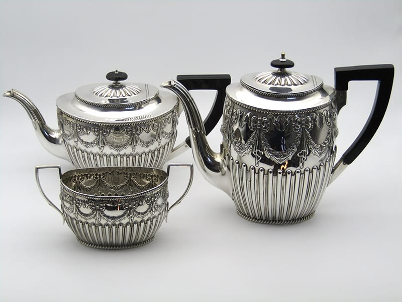 A silver tea, coffee, and sugar trio made by Harrison Brothers<br>& George Howson. Sheffield 1897.