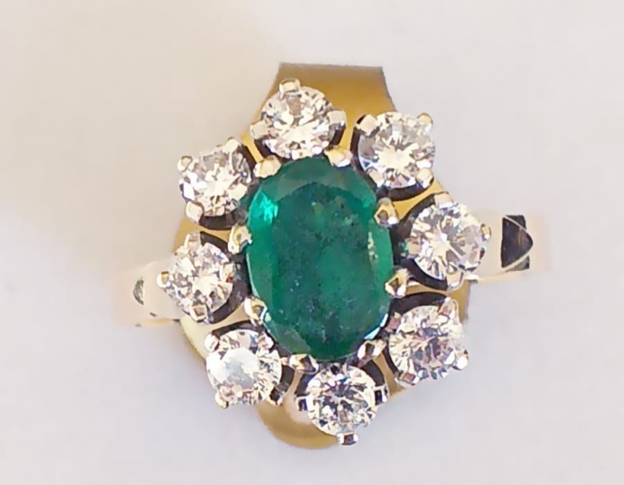 18 ct gold emerald and diamond ring.