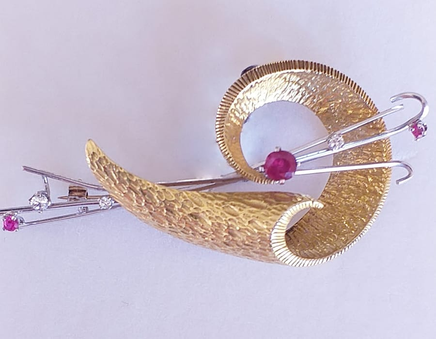 18 ct gold ruby and diamond brooch.