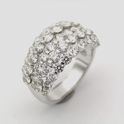 18K gold diamond ring set with graduating <br>round brilliant cut diamonds totalling 3.31cts.