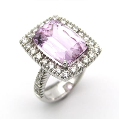 18K white gold ring set with a 9.63ct Kunzite, <br>with 0.95cts of round brilliant cut diamonds.