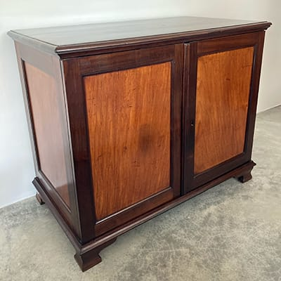 A fine Cape stinkwood and amboynalow cupboard, Cape Town, c. 1780.A combination of indigenous stinkwood and exotic timbers - in this case amboyna - is often found in patrician furniture, produced in Cape Town towards the last quarter of the 18th century.