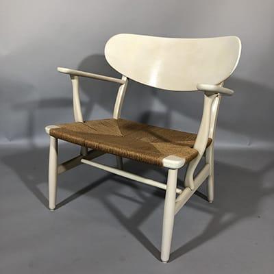 Hans Wegner (DK 1914-2007) CH22 lounge chair, design 1950. Carl Hansen & son, Denmark. Original painted oak & paper cord.