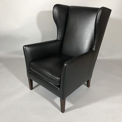 Danish Wingback Armchair. Elegant form armchair, c.1960s. Design attributed to Borge Mogensen, Denmark. Reupholstered in leather.