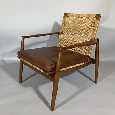 Finn Juhl (Denmark 1912-1989). Easy chair SW 96, designed 1956. Cabinetmaker Soren Willadsen Mobelfabrik, Denmark. Oak frame with teak arms and original woven cane seat & back. New leather cushions. 73 x 71,5 x 76,5 cm (w x d x h)