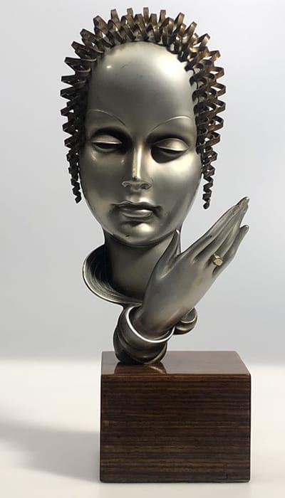 Stefan Dakon (Austria 1904-97). Head of a Lady, 1920s. Original patinated bronze with zebrano wood base.Impressed Dakon, Austria & foundry mark. H: 35 cm.