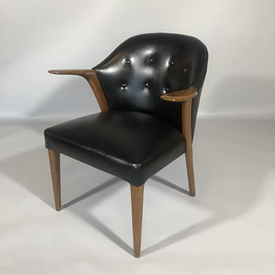 Knud A. Risager Hansen, Dk. Model 31 armchair, design 1960. Slagelse Mobelvaerk, Denmark. Rare brown-oak frame, reupholstered in leather. Note : Brown oak results from fungal attack in the growing tree, causing the heartwood to turn a rich deep brown. It is rare & highly valued for furniture.