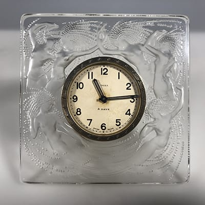 Rene Lalique (France 1860-1945). Pendulette 8 jours Naiades, c.1920s. Designed in 1926, this example in clear & frosted glass. Engraved signature in script R.Lalique France. 11,3 x 11,3 cm.