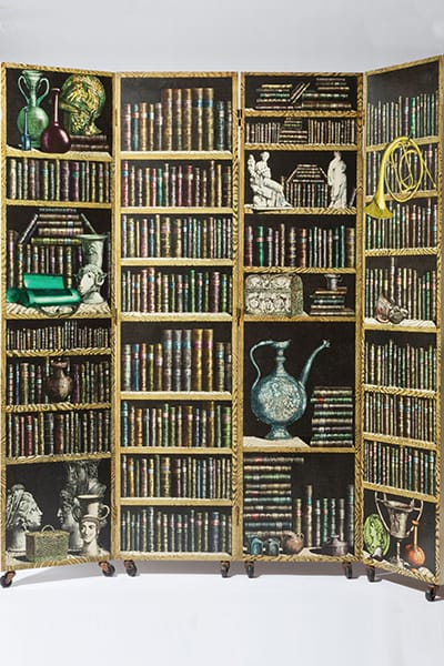 Piero Fornasetti (1913-1988) <br>Four panel Libreria screen, 1952. <br>Rare Tessuti decor on reverse panels. <br>Screen-printed, hand-applied & <br>hand-lacquered frame with reversible <br>hinges & casters. 200 x 200 cm.
