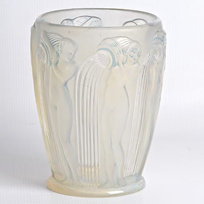 Rene Lalique (France 1860-1945) Danaides <br>opalescent glass vase, 1926. <br>Opalescent glass with relief & intaglio <br> moulded design, and blue staining. <br> Stencil signature. Height : 18,5 cm. <br>(Reference : Marcilhac no. 972).