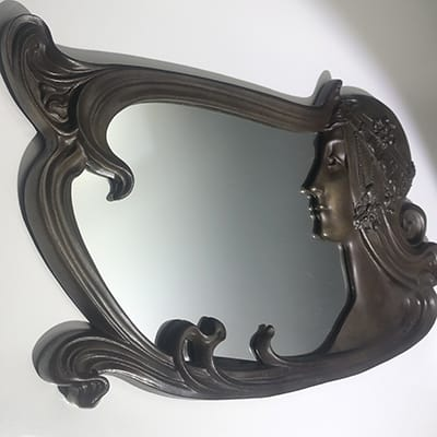 Charles Emile Janchery (1873-1937). Tete Byzantine mirror, c.1900. Cast metal mirror frame, with bronze finish. Original mirror available. Signed 44 x 75 cm. Reference : Art Nouveau Sculpture, Alastair Duncan, illustrated on page 25
