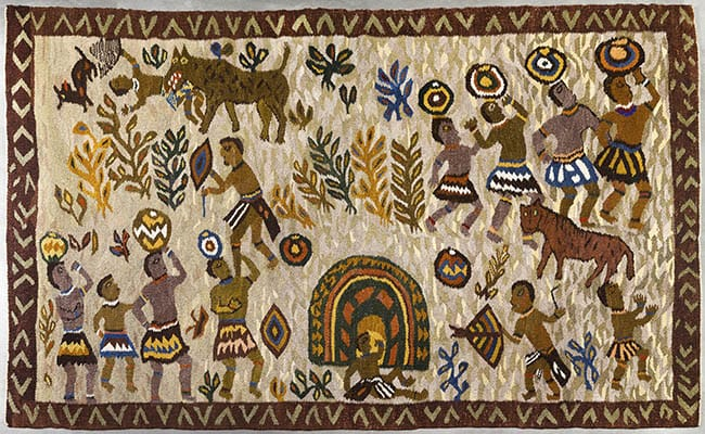 """Rorke's Drift (ELC Art and Craft Centre)<br> """"Zulu Kraal"""" hand woven and dyed <br>karakul wool Rorke's Drift label stamped, <br>numbered 128 and dated 80 140 x 225cm<br> Provenance: Private Collection, Canada, acquired <br>directly from the Centre in 1980."""