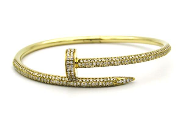 18K yellow gold Cartier Juste Un Clou Bracelet <br>(Just A Nail Bracelet) set with a total of 3.39cts of diamonds.
