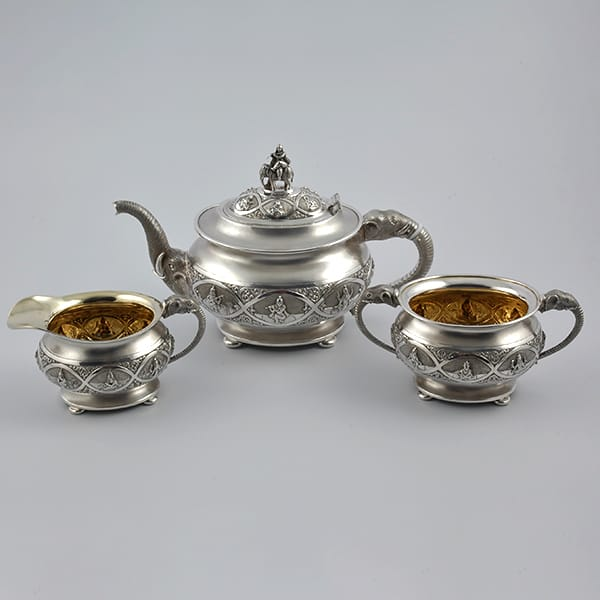 """Three-piece Indian silver tea service in original <br>presentation case by C. Venkataram Chetty & Sons, <br>Bangalore 1933. Accompanied with original sales Invoice <br>the design called """"Indian pattern."""