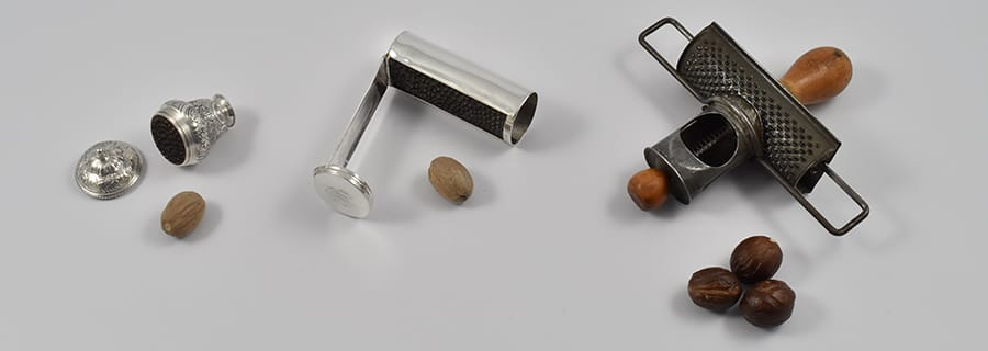 Collection of antique nutmeg graters ranging from Mid -18th century silver Rococo urn shape nutmeg grater by Samuel Meriton I, Circa 1740-1750 to an American late 19th century tin nutmeg grater called 'The Edgar' Circa 1896.